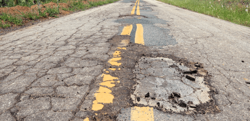 bigstock-Damaged-Roadway-Edit-90484274-e1455671502981